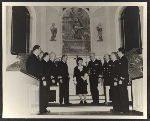Violet Oakley and naval officers at the dedication of her triptych altarpiece Christ the Carpenter at the Philadelphia Naval Base Chapel