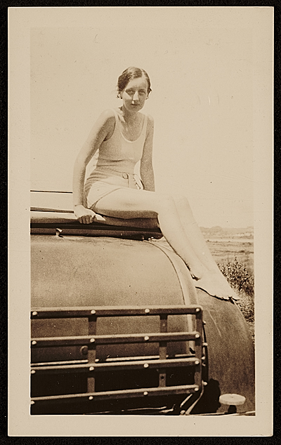 Elizabeth Orr sitting on a car