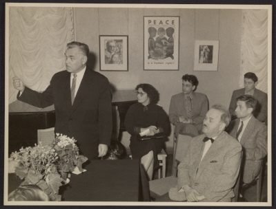Lecturer and attendees at a talk given at an exhibition of American Graphic Art in Moscow
