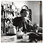 Diego Rivera eating at a table