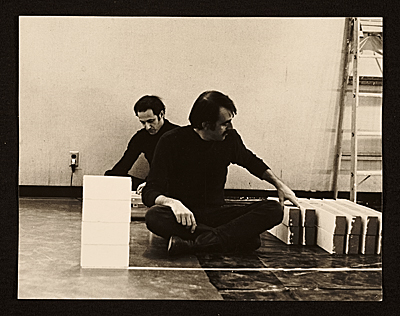 [Steve Reich and William Wiley sitting on the floor]