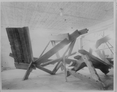Mark di Suvero, large wooden sculpture
