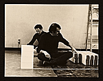 Steve Reich and William Wiley sitting on the floor