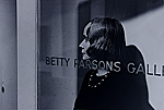 [Betty Parsons standing in the doorway of her gallery ]