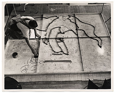 Man working on a floor mural