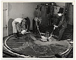 Men working on a floor mural