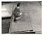 Woman working on a floor mural