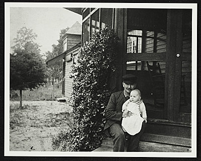 [John Frederick Peto on the porch of his home in Island Heights, New Jersey, holding his daughter Helen]