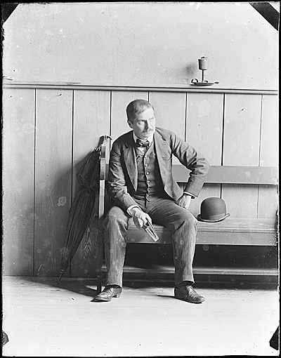 John F. Peto seated on a bench