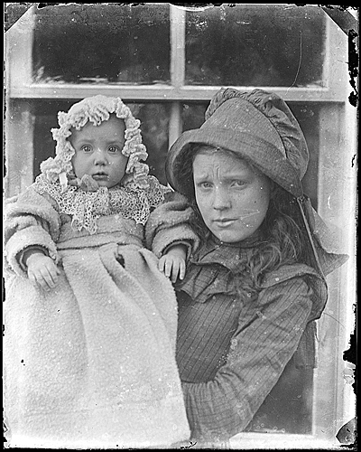 [Infant Helen Peto and woman]