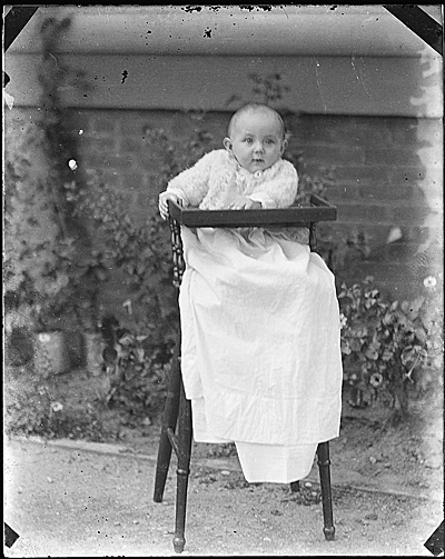 [Infant Helen Peto in a highchair]