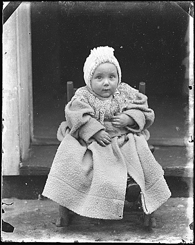 Infant Helen Peto in chair