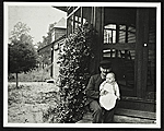 John Frederick Peto on the porch of his home in Island Heights, New Jersey, holding his daughter Helen