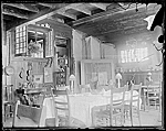 Interior of John F. Petos Island Heights house, view of dining room table