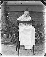 [Infant Helen Peto in a highchair ]
