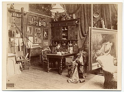 Fernand Cormon at a desk in his studio
