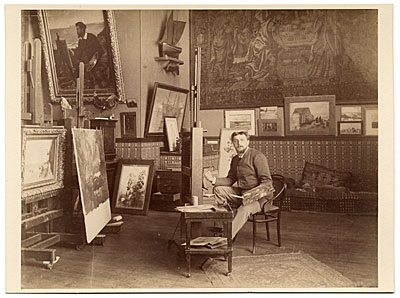 [Ernest Ange Duez at an easel in his studio]