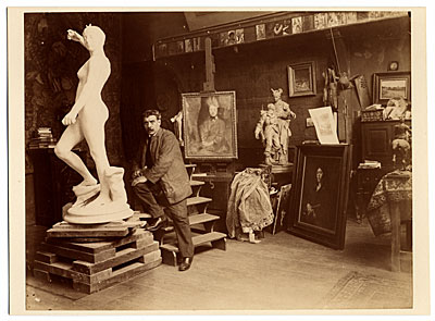 Jean Falguiere in his studio with his work