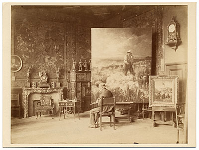 Charles Jacques painting in his studio