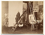 William Bouguereau in his studio on a ladder