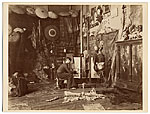 Georges Rochegrosse in his studio, painting