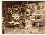 Alfred Roll in his studio, painting