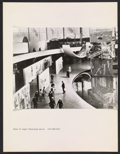 [Interior view of the United States Pavilion at the Brussels World's Fair, with focus on Saul Steinberg's mural The Americans]