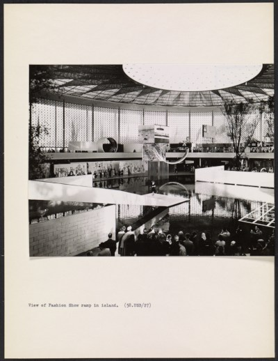[Interior view of the United States Pavilion at the Brussels World's Fair, with fashion show in progress]