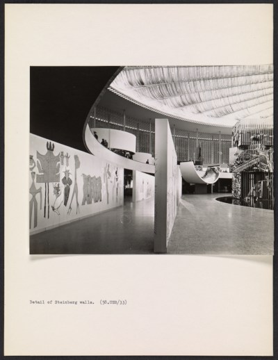 Interior of the United States Pavilion at the Brussels Worlds Fair, with eye-level view of Saul Steinbergs mural The Americans