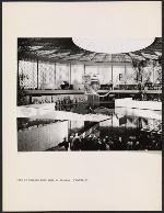 [Interior view of the United States Pavilion at the Brussels World's Fair, with fashion show in progress ]