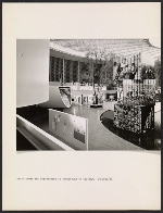 Interior view of the United States Pavilion at the Brussels Worlds Fair, with focus on the photo tower and streetscape