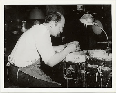 Jackson Pollock at potters wheel in the East Hampton studio of Mrs. Larry Larkin