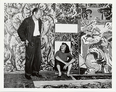 [Jackson Pollock and Lee Krasner in front of his work]