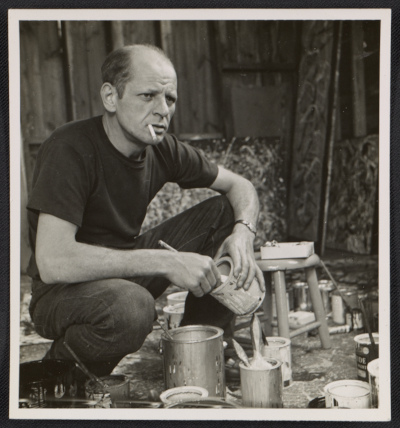 [Jackson Pollock holding a can of paint]