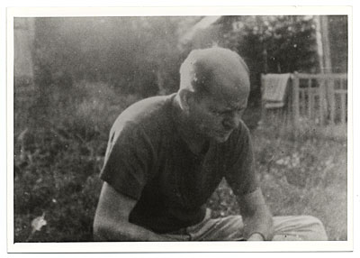Jackson Pollock seated in the grass