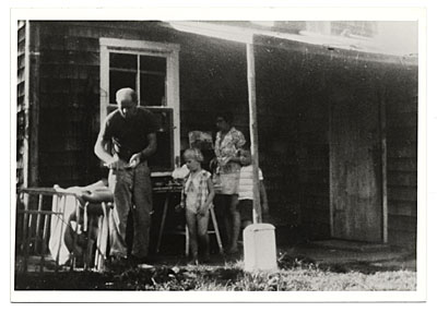 [Jackson Pollock and family on an outdoor porch]