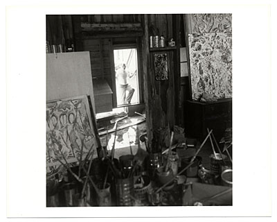 [Jackson Pollock at the door of his studio]