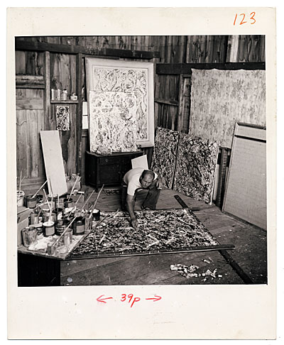 Jackson Pollock painting in his studio