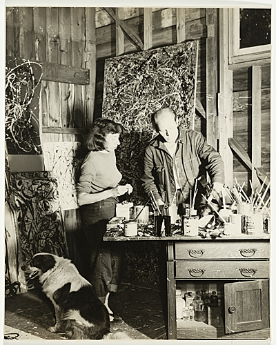 Jackson Pollock and Lee Krasner in his studio