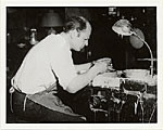 Jackson Pollock at potter's wheel in the East Hampton studio of Mrs. Larry Larkin