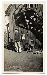 Jackson Pollock standing next to a barn