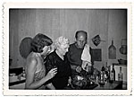 Lee Krasner, Stella Pollock and Jackson Pollock carving a turkey