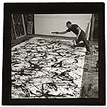 Jackson Pollock working on a painting