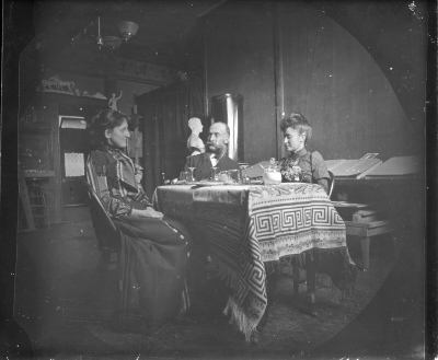 [Two women and a man at a table]