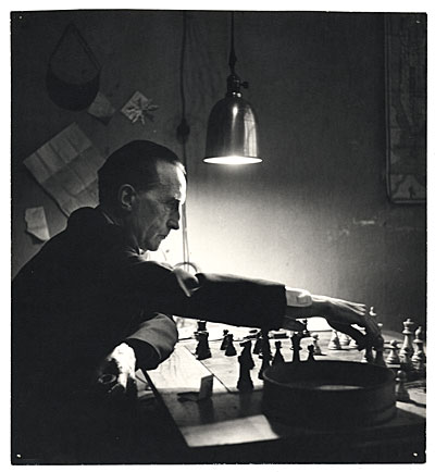 [Marcel Duchamp playing chess in his studio]