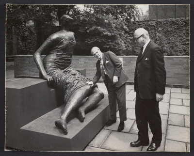Andrew Ritchie and Henry Moore with Moores sculpture Draped seated woman at Yale