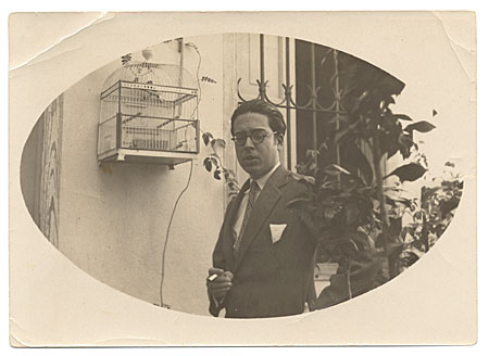 [Photograph of Enrique Riverón outside in garden]
