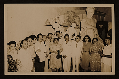 [Enrique Riveron with Amelia Pelacz and other Cuban artists]