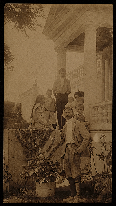 John H. Twachtman with his family on their front porch in Greenwich, Conn.