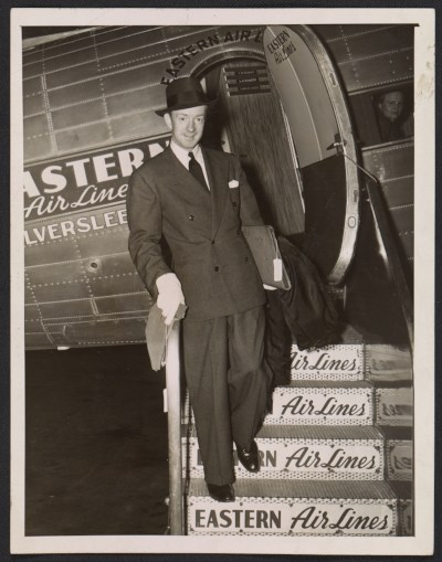[Terence Robsjohn-Gibbings disembarking from Eastern Air Lines airplane]